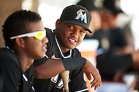 GCL Marlins Yefry Reyes (7) in the dugout during the second game of a doubleheader against the GCL Cardinals on August 13, 2016 at Roger Dean Complex in Jupiter, Florida.  GCL Cardinals defeated GCL Marlins 2-0.  (Mike Janes/Four Seam Images)