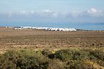 White cuboid buildings of coastal village La Caleta de Famara, Lanzarote, Canary islands, Spain
