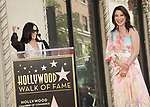 Lucy Liu Honored With Star On The Hollywood Walk Of Fame on May 01, 2019 in Hollywood, California.<br /> a_Lucy Liu 006  Demi Moore