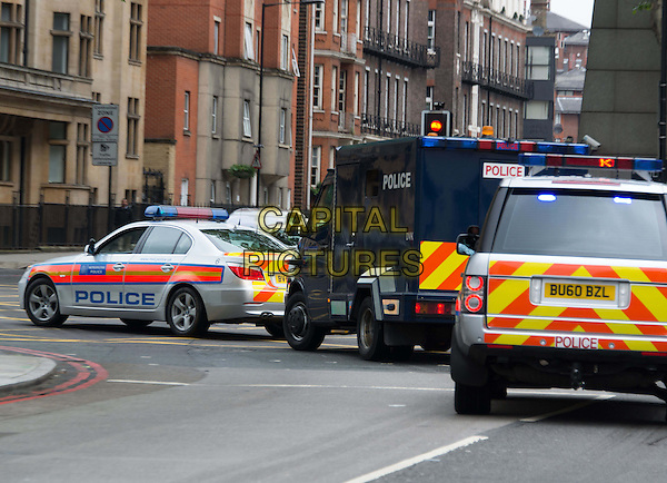 Michael Adebowale driven away from Westminster Magistrates' Court, London, charged with the murder of soldier Lee Rigby, London, England.<br /> May 30th, 2013<br /> gv general view police car van traffic street road sirens <br /> CAP/BF<br /> &copy;Bob Fidgeon/Capital Pictures
