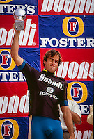 Two Times World Surfing Champion Tom Curren (USA) on the stage after winning the 1990 Boundi Pro Portugal: Photo: Joliphotos.com