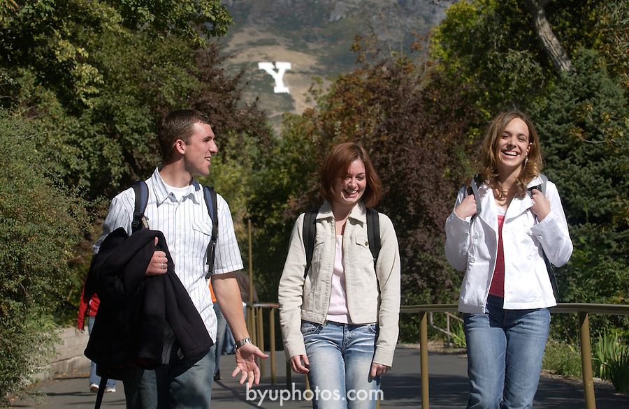""".""""A Day in the Life of BYU""""..9/22/04..GCS- Students leaving campus for the day. Y Mountain in the Background..L->R .Matthew Graff (232-9620).Amy Shoemaker (Beige jacket).Vicki Bingham (631-5646)..Photo by Jaren Wilkey/BYU..Copyright BYU PHOTO 2004 .photo@byu.edu  801-422-7322.0409-30 GCS Day at BYU."""