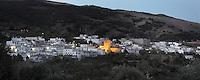 Juviles, with floodlit Church, 16th century, Alpujarra, Andalucia, Southern Spain. Moorish influence is seen in the distinctive cubic architecture of the Sierra Nevada's Alpujarra region, reminiscent of Berber architecture in Morocco's Atlas Mountains. Photograph by Manuel Cohen.