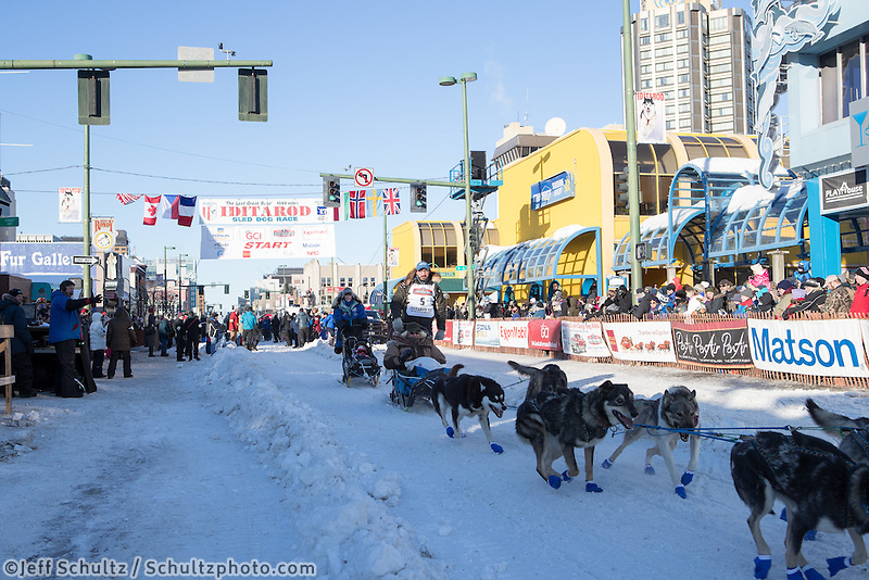Cody Strathe and team leave the ceremonial start line with an Iditarider and handler at 4th Avenue and D street in downtown Anchorage, Alaska on Saturday March 4th during the 2017 Iditarod race. Photo © 2017 by Brendan Smith/SchultzPhoto.com.