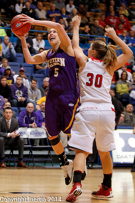 SIOUX FALLS, SD - MARCH 9:  Ashley Luke #5 from Western Illinois takes the ball to the basket against xxxxxxx #30 from the University of South Dakota in the second half of their semifinal game at the 2014 Summit League Tournament in Sioux Falls, SD.  (Photo by Dave Eggen/Inertia)