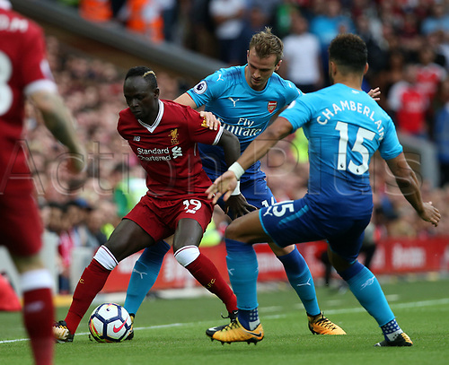 27th August 2017, Anfield, Liverpool, England; EPL Premier League football, Liverpool versus Arsenal; Sadio Mane of Liverpool holds off Alex Oxlade-Chamberlain  and Rob Holding of Arsenal of Arsenal