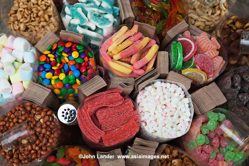 """Pinoy candy or fruit candies are common in the Philippines. People are enticed into eating them since most are based on fruits, so it is hoped that they are """"healthy"""".  It is considered fun to snack on sweets and when they are so colorful it makes sense."""