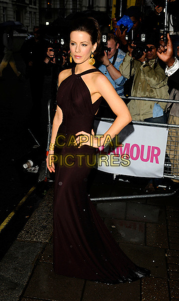 KATE BECKINSALE.Outside arrivals at The Glamour Women of the Year Awards 2008, Berkeley Square Gardens, London, England. .June 3rd, 2008.full length hand on hip aubergine dress brown long maxi gold bracelets .CAP/CAN.©Can Nguyen/Capital Pictures.