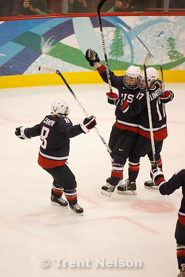 Trent Nelson  |  The Salt Lake Tribune.USA's Caitlin Cahow, USA's Jocelyne Lamoureux and Karen Thatcher celebrate Thatcher's goal to put USA up 5-1. USA's Angela Ruggiero at bottom. USA vs. Sweden, women's hockey, at the XXI Olympic Winter Games in Vancouver, Monday, February 22, 2010.
