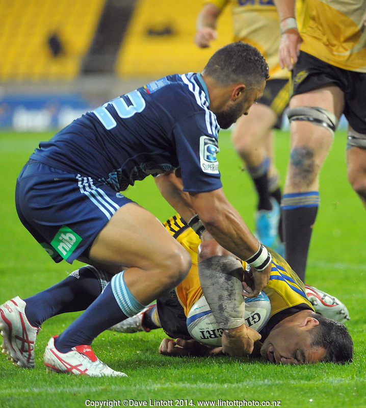 Motu Matu'u drives over the tryline through Benji Marshall to score at fulltime during the Super Rugby match between the Hurricanes and Blues at Westpac Stadium, Wellington, New Zealand on Friday, 23 February 2014. Photo: Dave Lintott / lintottphoto.co.nz