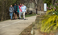 Braden Reed (from left), Ryder Biscup, brother Caden Biscup, Nathan White and Logan Sticht, all of Bentonville, walk Wednesday, March 11, 2020, on the Razorback Greenway near Compton Gardens in Bentonville. Check out nwaonline.com/200312Daily/ for today's photo gallery<br /> (NWA Democrat-Gazette/Ben Goff)