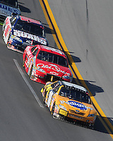 Apr 26, 2009; Talladega, AL, USA; NASCAR Sprint Cup Series driver Kyle Busch (18) leads Tony Stewart (14) and Dale Earnhardt Jr (88) during the Aarons 499 at Talladega Superspeedway. Mandatory Credit: Mark J. Rebilas-