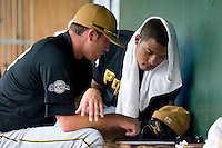 West Virginia pitcher Jeremy Jeffress (45) looks over the pitching chart with teammate Brae Wright (33) after giving up 6 unearned runs in 4 innings of work versus Greenville at West End Field in Greenville, SC, Sunday, July 1, 2007.