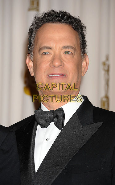 TOM HANKS.Press room at the 83rd Annual Academy Awards at the Kodak Theatre, Hollywood, California, USA. .February 27th, 2011.Pressroom oscars headshot portrait black tuxedo jacket bow tie .CAP/ROT/TM.© Tony Michaels/Roth Stock/ Capital Pictures