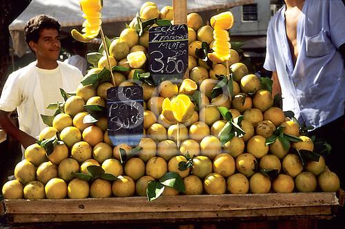 Rio de Janeiro, Brazil. Street market stall selling oranges in a pyramid pile 'boa para suco' (good for juice).