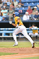 Beer City Tourists third baseman Colton Welker (24) runs to first base during a game against the Lakewood BlueClaws at McCormick Field on June 1, 2017 in Asheville, North Carolina. The Tourists defeated the BlueClaws 8-5. (Tony Farlow/Four Seam Images)