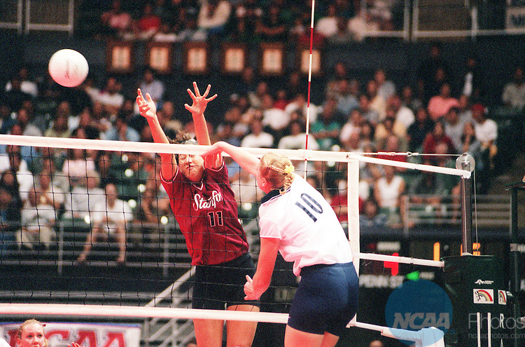 18 DEC 1999: Penn State OH Katie Schumacher (10) sends the ball past Stanford OH Lindsey Yamasaki (11) during the Division I Women's Volleyball Championship held at the Stan Sheriff Center in Honolulu, HI. Penn State defeated Stanford 3-0 for the championship title. Chas Hendrickson/NCAA Photos.