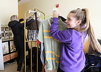 (L-R) Emma Keller and Lucy Baxter help move a resident's clothes at Magnolia Springs Bridgewater, an assisted living community in Carmel.