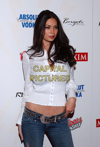 TARA PATRICK.The 2006 Maxim Rock City Super Bowl Party held at the Max M. Fisher Music Center, Detroit, Michigan, USA..February 4th, 2006.Photo: Jason Nelson/AdMedia/Capital Pictures.Ref: JN/ADM.half length white top.www.capitalpictures.com.sales@capitalpictures.com.© Capital Pictures.