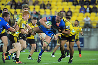 Pieter-Steph du Toit is tackled during the Super Rugby match between the Hurricanes and Stormers at Westpac Stadium in Wellington, New Zealand on Saturday, 23 March 2019. Photo: Dave Lintott / lintottphoto.co.nz
