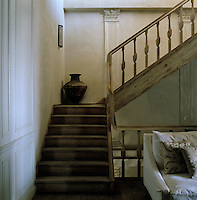 Each landing is furnished as a sitting room as the hand-carved wooden staircase winds up through the house