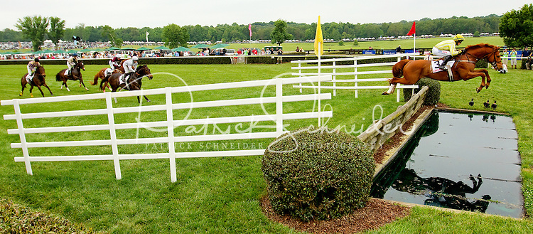 Event photography from the 2012 annual Queen's Cup Steeplechase horse race, held in Mineral Springs NC the last Saturday of each April. Attracting thousands of spectators annual for the sport and the social outing, the Queen's Cup features athletic thoroughbreds competing at speeds of 30 mph while clearing four-and-a-half-foot jumps and water features.