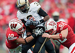 October 31, 2009: Wisconsin Badgers defenders Devin Smith (10) and Kyle Wojta (62) tackle Purdue Boilermakers wide receiver Waynelle Gravesande (3) during an NCAA football game at Camp Randall Stadium on October 31, 2009 in Madison, Wisconsin. The Badgers won 37-0. (Photo by David Stluka)