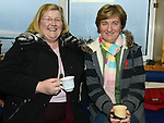 Mary Kirk and Aileen Conroy enjoying the mulled wine and mince pies at Clogherhead Lifeboat Station. Photo:Colin Bell/pressphotos.ie