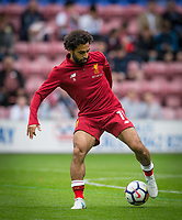 Mohamed Salah of Liverpool warms up ahead of the pre season friendly match between Wigan Athletic and Liverpool at the DW Stadium, Wigan, England on 14 July 2017. Photo by Andy Rowland.