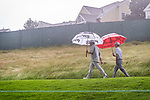 CROMWELL, CT. 21 June 2019-062119 - PGA Tour players Louis Oosthuizen, left, and Kevin Streelman make their way up the 18th hole in the pouring rain, during the second round of the Travelers Championship at the TPC River Highlands in Cromwell on Thursday. Bill Shettle Republican-American