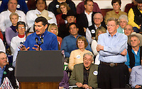 Montana Republican congressman Denny Rehberg speaks at rally while Republican senator Conrad Burns listens before President George W. Bush appeared at a campaign rally for the senator at MetraPark in Billings, Mont., Nov. 2, 2006. Burns lost the election to Jon Tester.
