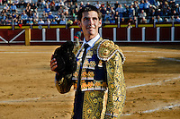 A Spanish bullfighter (matador) waves to the crowd after killing the bull at the bullring in Fuengirola, Spain, 28 April 2007.