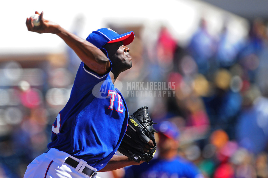 Mar. 15, 2012; Surprise, AZ, USA; Texas Rangers pitcher Roman Mendez throws in the third inning against the Oakland Athletics at Surprise Stadium.  Mandatory Credit: Mark J. Rebilas-