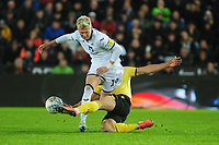 Sam Surridge of Swansea City is tackled by Shaun Hutchinson of Millwall during the Sky Bet Championship match between Swansea City and Millwall at the Liberty Stadium in Swansea, Wales, UK. Saturday 23rd November 2019