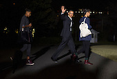 United States President Barack Obama walks with his daughters Sasha (L) and Malia as the First Family departs the White House for a family vacation to Hawaii, on December 20, 2013 in Washington, D.C. <br /> Credit: Kevin Dietsch / Pool via CNP