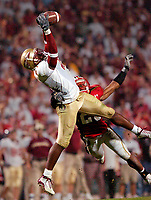 Florida State WR Dominic Robinson (21) makes a leaping catch down the middle of the field over top of Maryland DB Ray Custis (26).  Maryland upset #5 Florida State 20-17 October 30, 2004 at Byrd Stadium in College Park, MD.