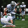 Cairo Santos #8 of the New York Jets follows through on a kick as teammate Lachlan Edwards #4 holds for him during practice at the Atlantic Health Jets Training Center in Florham Park, NJ on Sunday, July 29, 2018.