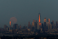 EAGLE ROCK, NJ - JUNE 09: The Strawberry Moon rises over lower Manhattan next to One World Trade Center on June 06, 2017 in Montclair, New Jersey. Photo by VIEWpress/Eduardo MunozAlvarez