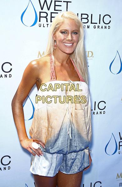 Heidi Montag .hosts Sexy Poolside Affair at Wet Republic at MGM Grand Las Vegas.  Las Vegas, Nevada, USA 18th June 2011.half length hand on hip tanned  silk peach blue playsuit halterneck bikini .CAP/ADM/MJT.© MJT/AdMedia/Capital Pictures.