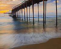 Cape Hatteras National Seashore, Avon, North Carolina<br /> Sunrise reflections on surf and waves beneath the Avon fishing pier