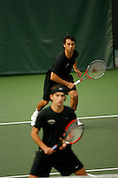 26 January 2006: Stanford's Jon Wong with partner Blake Muller in the foreground during doubles action during the Cardinal's 6-1 win over Hawaii at the Taube Family Tennis Stadium in Stanford, CA.