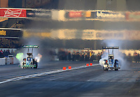 Feb 12, 2016; Pomona, CA, USA; NHRA top fuel driver Leah Pritchett (left) races alongside teammate Dave Connolly during qualifying for the Winternationals at Auto Club Raceway at Pomona. Mandatory Credit: Mark J. Rebilas-USA TODAY Sports