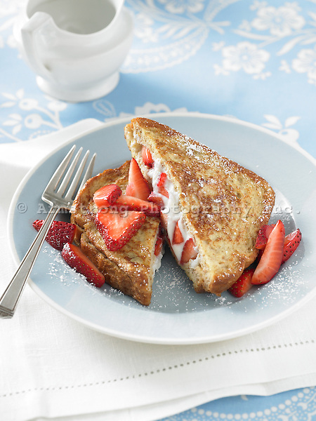 French toast stuffed with ricotta cheese and strawberries, topped with powdered sugar