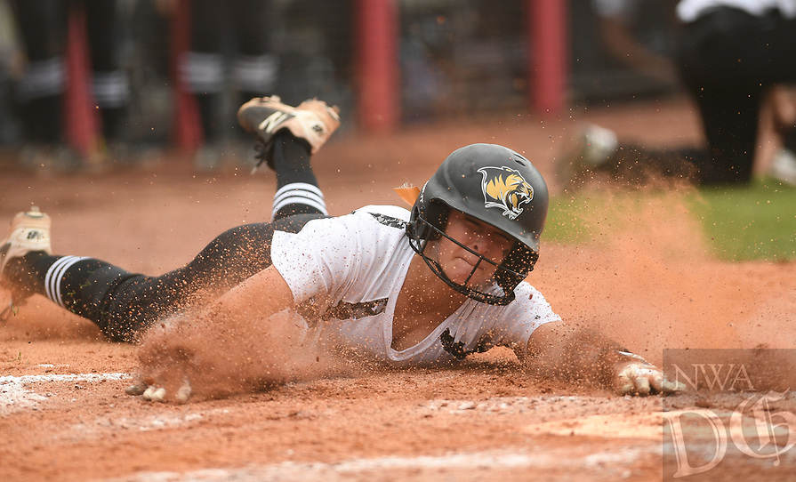 NWA Democrat-Gazette/J.T. WAMPLER Bentonville's Morgan Nelson slides into home plate for a score against  North Little Rock Friday May 19, 2017 during the 7A State Championship game at Bogle Park in Fayetteville. Bentonville won 11-3.