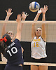 Wantagh No. 15 Jillian Graham, right, defends against a spike attempt by South Side No. 10 Kate Keady during a Nassau County varsity girls' volleyball match at Wantagh High School on Friday, October 23, 2015. Wantagh won 25-15, 25-17, 28-26.<br /> <br /> James Escher