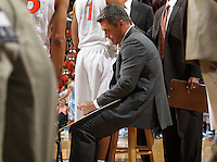 Virginia head coach Tony Bennett thinks in the huddle during an NCAA basketball game Monday Jan. 20, 2014 in Charlottesville, VA. Virginia defeated North Carolina 76-61.