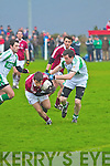 Dromid's Gearoid O'Sullivan stayes on his feet and comes out the best as he twists and turns to break free of Kanturk's Eoin O'Connor in this challenge.