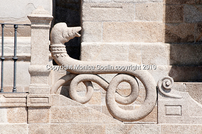 Detail of the railing, shaped like a serpent, for the steps leading up to the doors of the Cathedral of Porto, Portugal.
