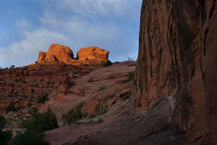 Late Sunlight lights up a prominent geologic feature in Chockstone Canyon. Escalante, Utah