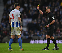 Brighton &amp; Hove Albion's Lewis Dunk is shown a yellow card by referee Stuart Attwell <br /> <br /> Photographer David Horton/CameraSport<br /> <br /> The Premier League - Brighton and Hove Albion v Chelsea - Sunday 16th December 2018 - The Amex Stadium - Brighton<br /> <br /> World Copyright &copy; 2018 CameraSport. All rights reserved. 43 Linden Ave. Countesthorpe. Leicester. England. LE8 5PG - Tel: +44 (0) 116 277 4147 - admin@camerasport.com - www.camerasport.com